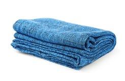 Folded blue blanket Stock Photos
