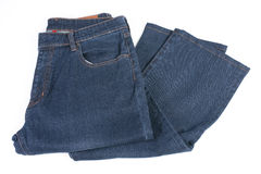 Folded blue jean. On white black ground Royalty Free Stock Photo