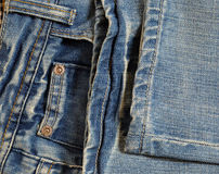 Folded blue jeans Royalty Free Stock Photos