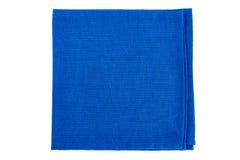 Folded blue textile napkin on white Stock Photography