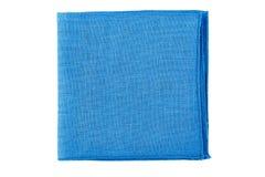 Folded blue textile napkin on white Stock Images
