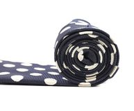 Folded blue tie with white speck Royalty Free Stock Photo