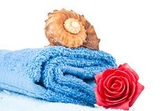 Folded blue towel Stock Images