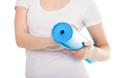 Folded blue yoga mat in woman hands Stock Photo