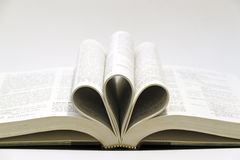 Folded book. An image of a open book folded into three curl at the centre royalty free stock photo