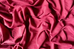 Folded ruby red cotton jersey fabric Royalty Free Stock Image