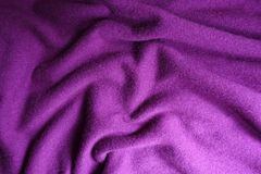 Folded Bright Violet Woolen Knitted Fabric Stock Image