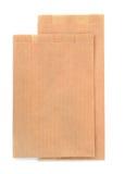 Folded brown kraft paper bags Stock Images