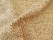 Folded burlap fabric. Close up of an old burlap fabric Royalty Free Stock Images