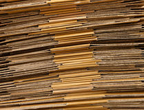 Folded cardboard. Stack of folded cartboard boxes royalty free stock photo
