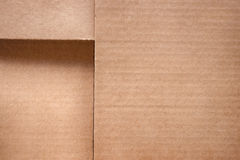 Folded cardboard box cover close up. Texture and background Royalty Free Stock Photos