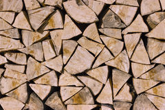 Folded chopped firewood. Chopped pine wood folded against the wall Stock Photos
