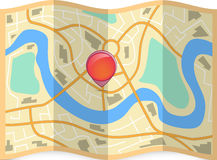Folded city map with pin on it Stock Image