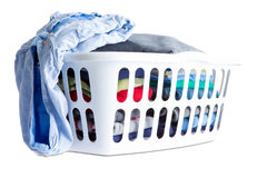 Folded Clean Clothes in a White Plastic Basket Royalty Free Stock Photos