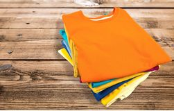 Folded. Clothing T-Shirt Shirt Heap Multi Colored Comfortable Royalty Free Stock Photos