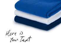 Folded cloths stack with space for text ,isolated on white Royalty Free Stock Photos