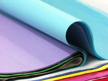 Folded Colored Paper. Sheets of folded and flat colored or construction paper Stock Image
