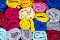 Folded colored towels are graphically pictorial of fabric. Colored towels graphically picturesque of fabric folded in disarray and colours royalty free stock photography