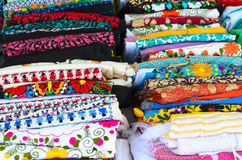 Folded colorful authentic Mexican women's shirts Royalty Free Stock Photos