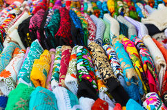 Folded colorful authentic Mexican women's shirts for sale at the. Craft market Stock Image