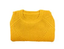 Folded cozy warm sweater on white backgroun. D, top view stock image