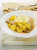 Folded crepe with pineapple and vanilla ice cream Royalty Free Stock Photo