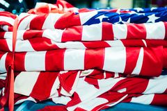 Folded crumpled american red white flag USA stock images