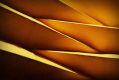 Folded and decorative yellow paper. Close-up of folded paper in yellow colour Royalty Free Stock Photos