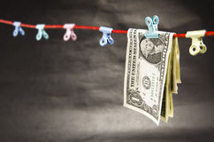 Folded Dollar Bills on a String Stock Photos