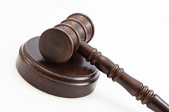 Folded down lwooden judge gavel and stand. Wooden judge gavel and wooden stand on a white background Stock Photo