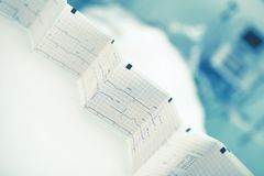 Folded ECG trace in the background of patient bed Royalty Free Stock Photos