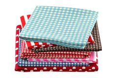 Folded fabric in different patterns Royalty Free Stock Photography