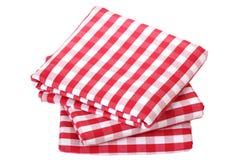 Folded fabric, gingham pattern. Isolated on white background Stock Images