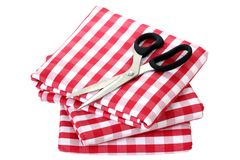 Folded fabric, gingham pattern. With a pair of scissors on it Royalty Free Stock Photos