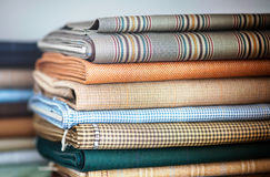 Folded fabrics in a neat stack Royalty Free Stock Photo