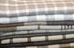 Folded fabrics. Stack of new fabrics in different colors and textures Stock Photo