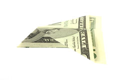 Folded five dollar bill paper airplane Stock Image
