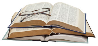 Folded glasses on three open books Royalty Free Stock Photos