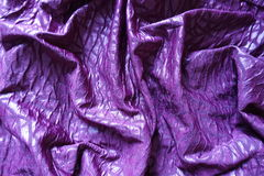 Folded glossy bright violet viscose fabric from above Stock Photography