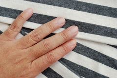Folded gray striped cotton. Stock Image