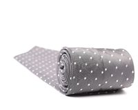 Folded gray tie with white speck. Stock Image