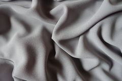 Folded grey crepe georgette fabric from above. Folded gray crepe georgette fabric from above royalty free stock photo