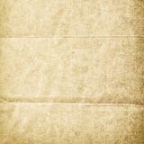 Folded grungy stained old paper Royalty Free Stock Photo