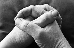 Folded hands. Rough hands folded in prayer Stock Image
