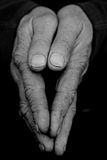Folded Hands II. Closeup of folded hands in black and white royalty free stock photos