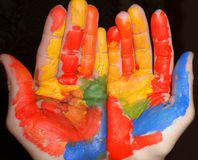 Folded hands painted. Folded colorful hands funny painted stock image