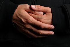 Folded hands of a priest Royalty Free Stock Photography
