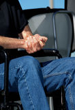 Folded Hands in a Wheelchair Royalty Free Stock Photos