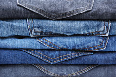 Folded jean stack background Royalty Free Stock Photo