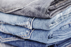 Folded jean stack close up Royalty Free Stock Image